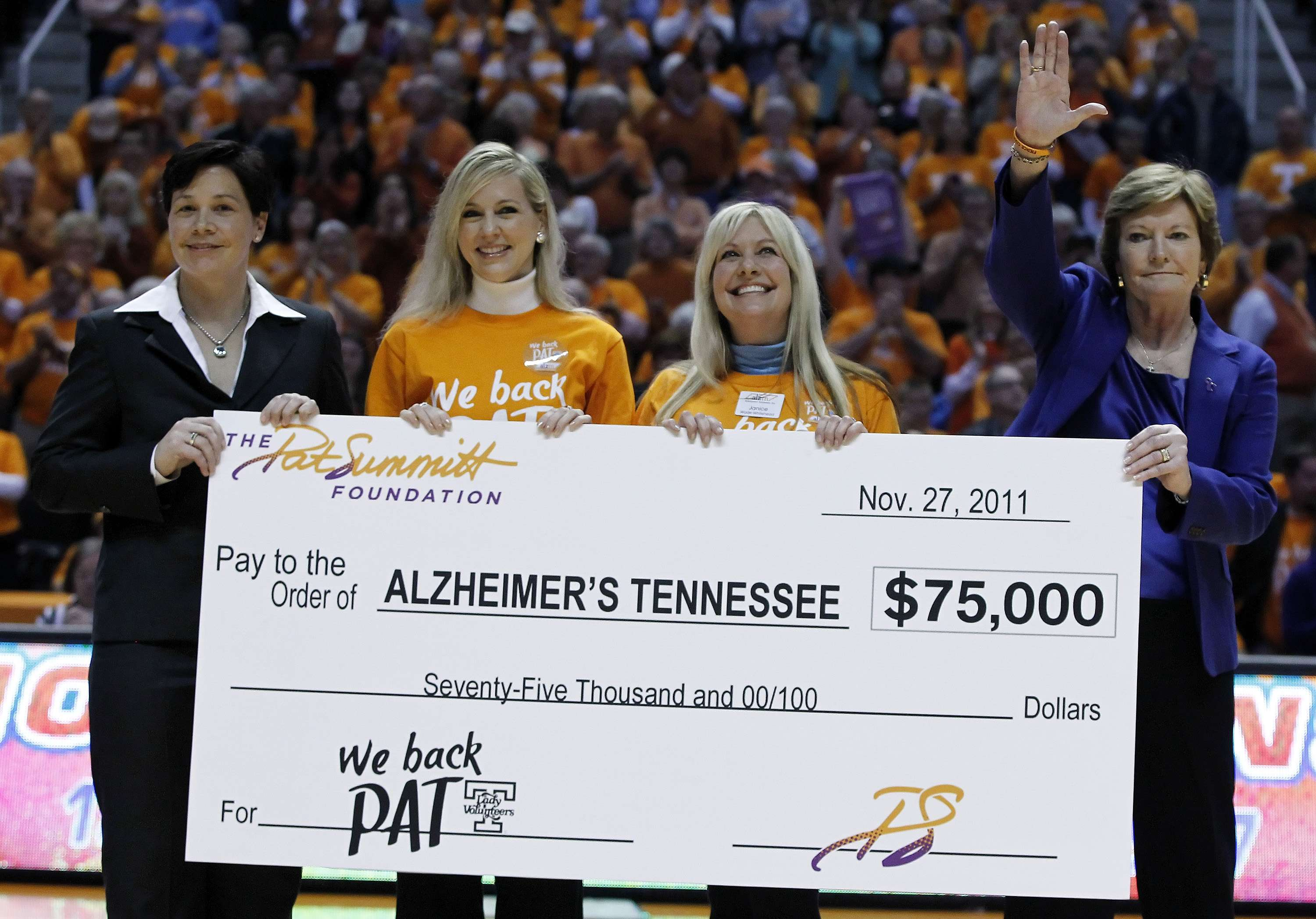 A check for $75,000.00 is presented by The Pat Summitt Foundation Fund to Alzheimer's Tennessee at the Baylor versus Tennessee game on November 27, 2011. From left to right: Danielle Donehew, Alzheimer's Tennessee representatives and Pat Summitt. Photo courtesy of the Associated Press.