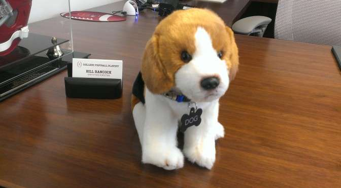 "Hancock's dog named ""Dog"" displayed prominently on his desk"