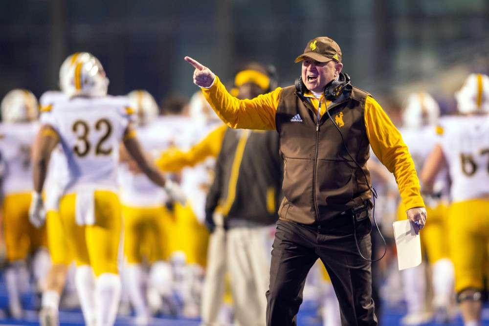 Craig Bohl coaching football at Wyoming