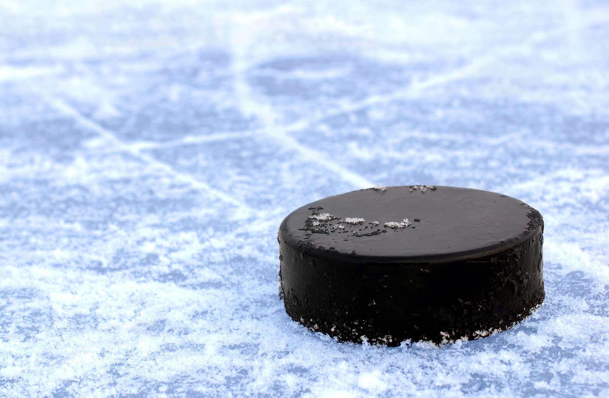 college hockey puck on ice